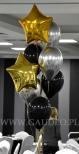 Balony z helem ułożone w stroik.