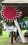 Balonowy lizak na pikniku firmowym.